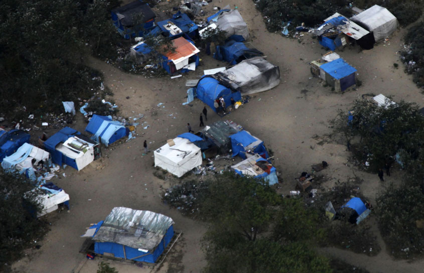 """Aerial view of a camp in the woods near Calais, known locally as the """"jungle"""""""